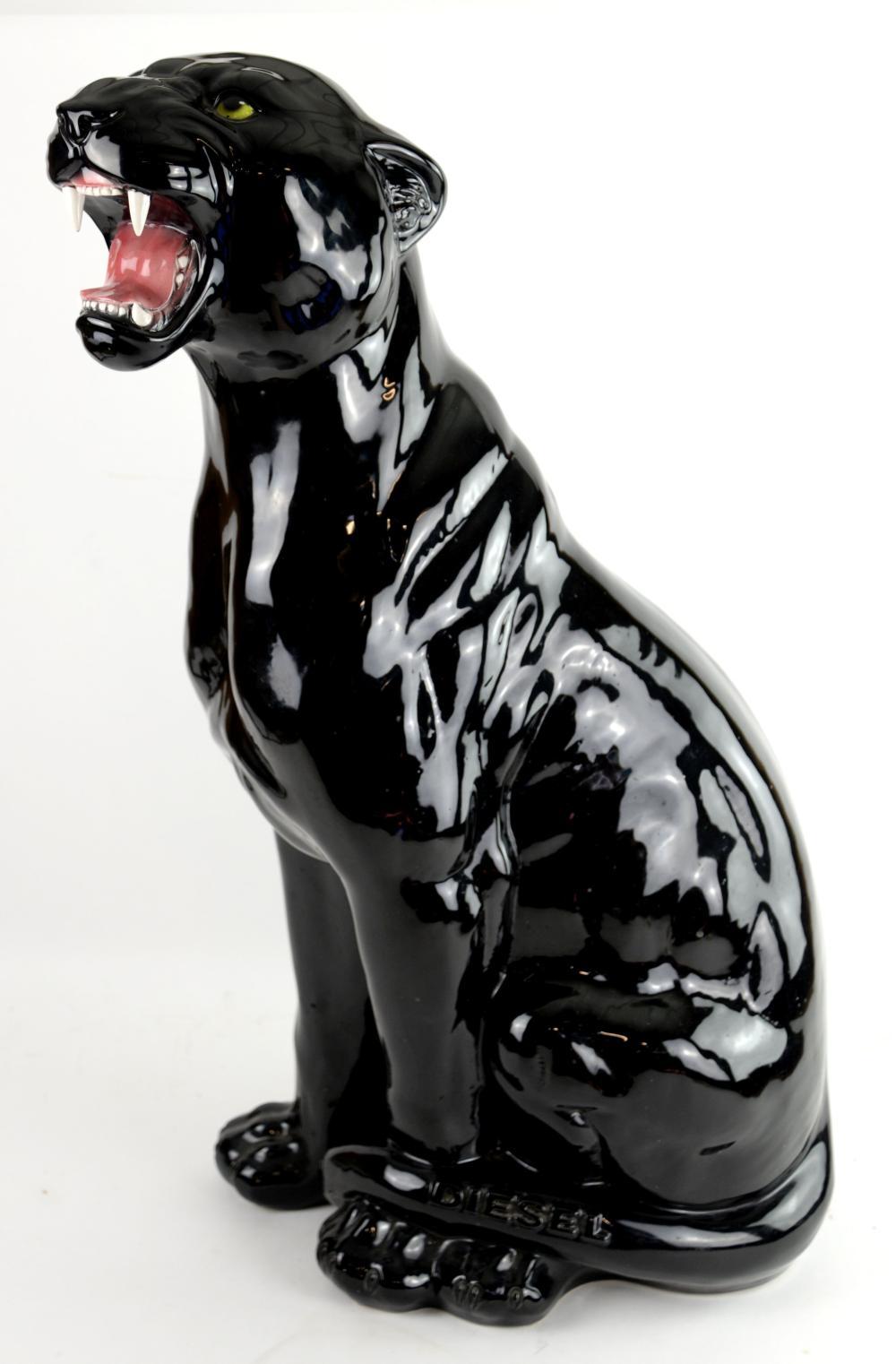 Large ceramic black glazed figure of a seated Pant