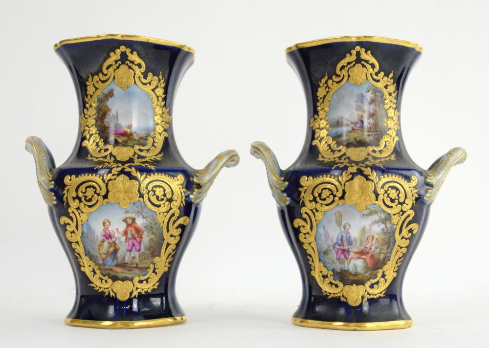 Pair of Sevres style blue ground vases painted wit