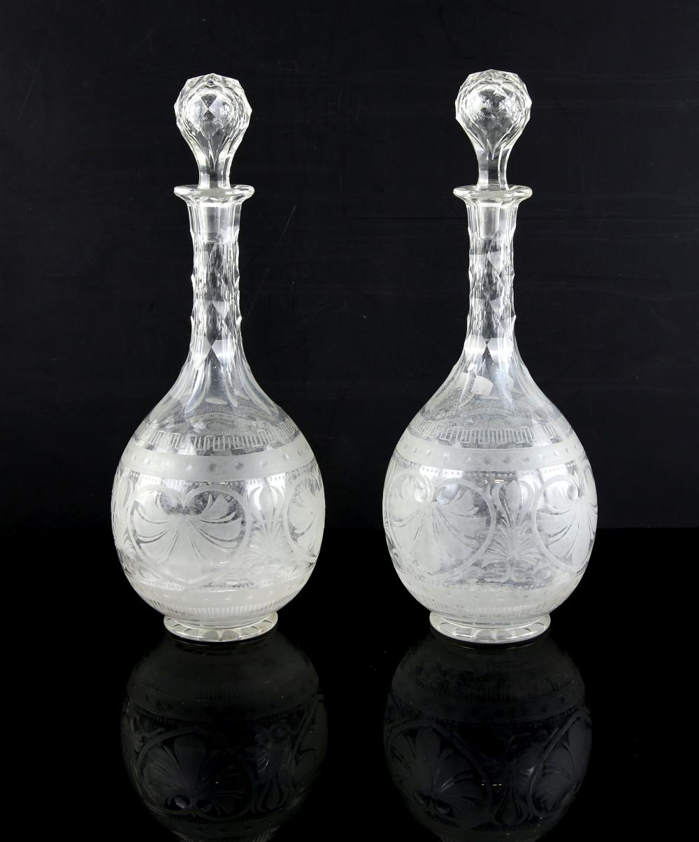 Pair of 19th century globe and shaft decanters, wi