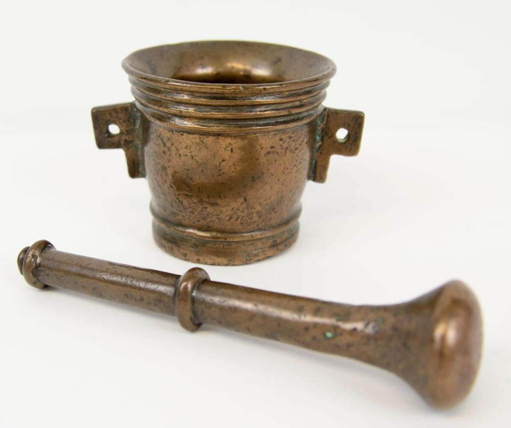 Bronze pestle and mortar, the mortar with twin lug