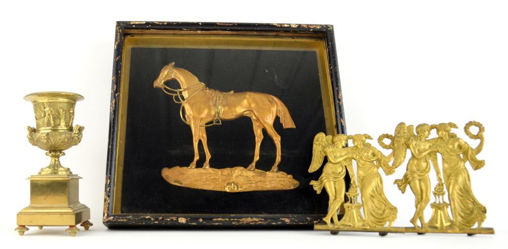 GIlt metal casting of a saddled horse, framed and
