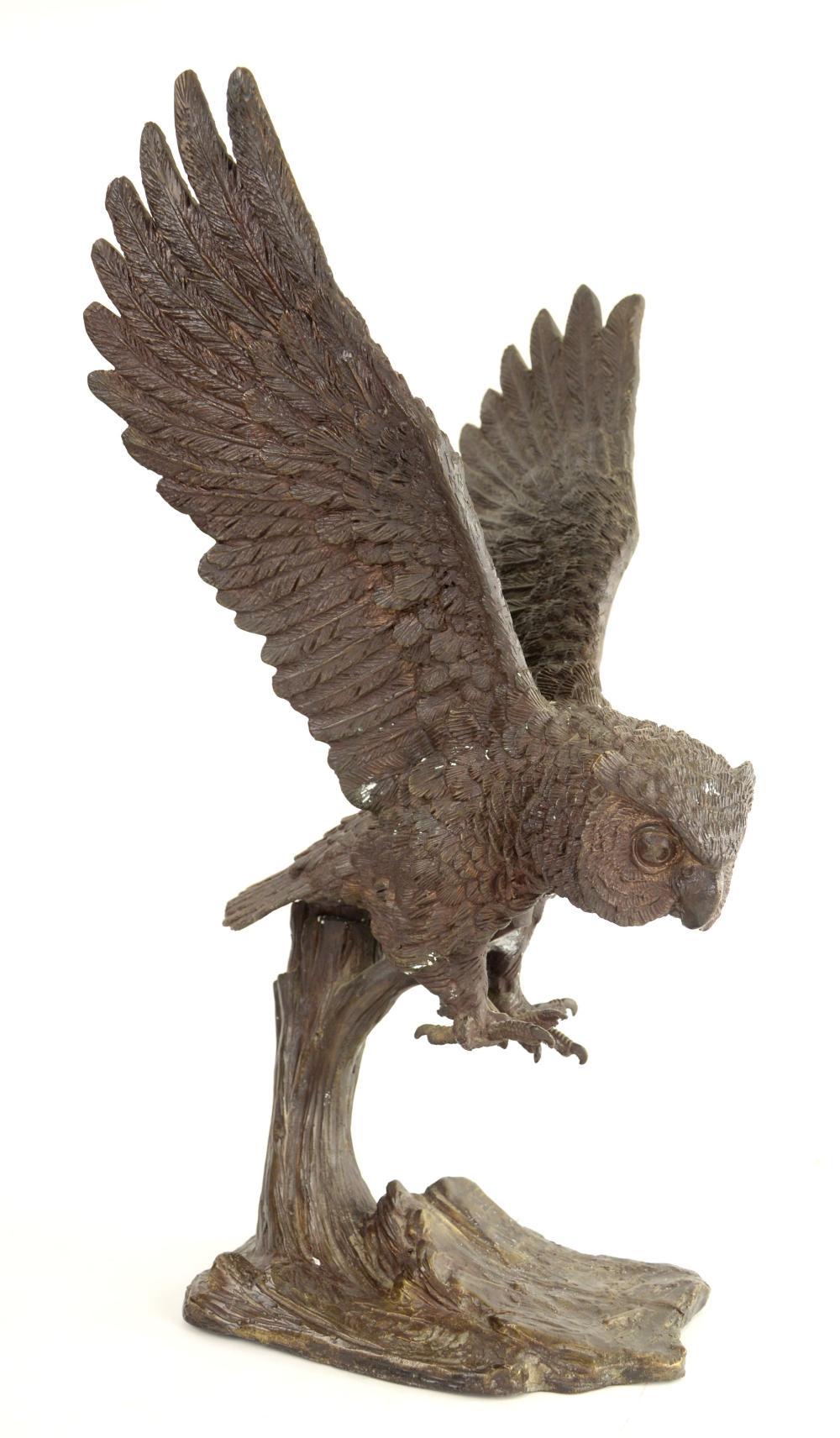 Bronze sculpture of an owl in flight, 60cm high