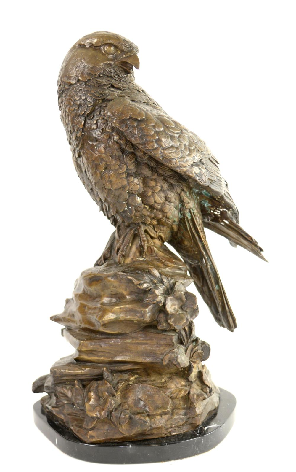 Bronze sculpture of an eagle on a rocky outcrop, i