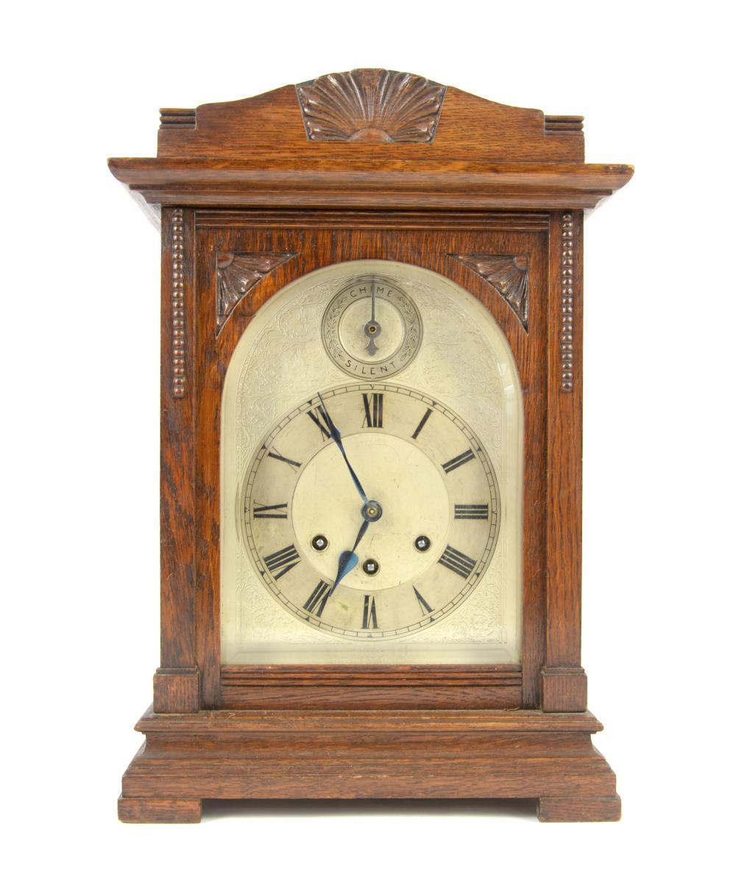 Oak cased mantle clock the German three train move