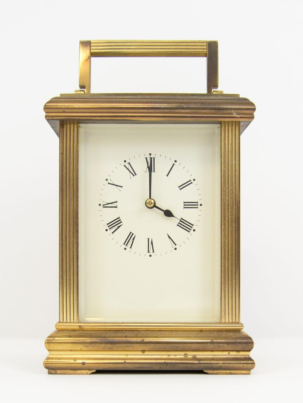 Brass and glass carriage clock, with eight day str