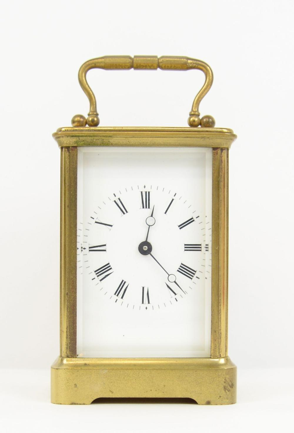Brass and glass carriage clock, with eight day lev