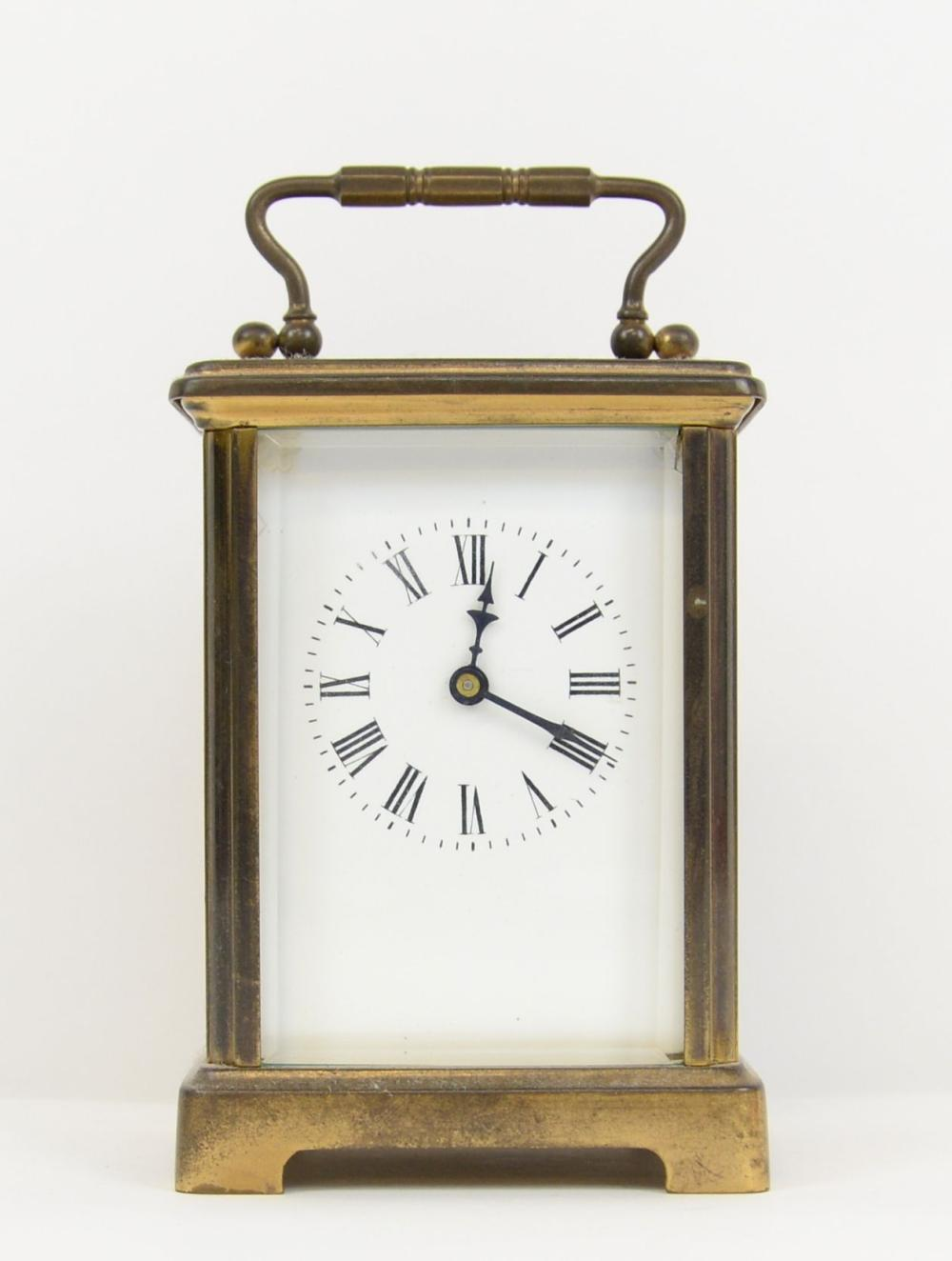 Brass and glass carriage clock, with eight day cyl