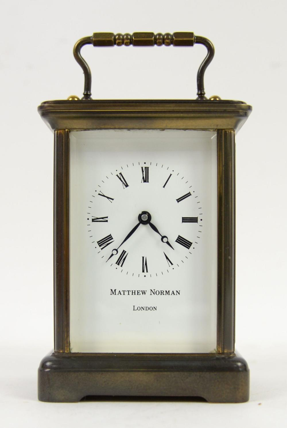 Modern glass and brass carriage clock with lever m