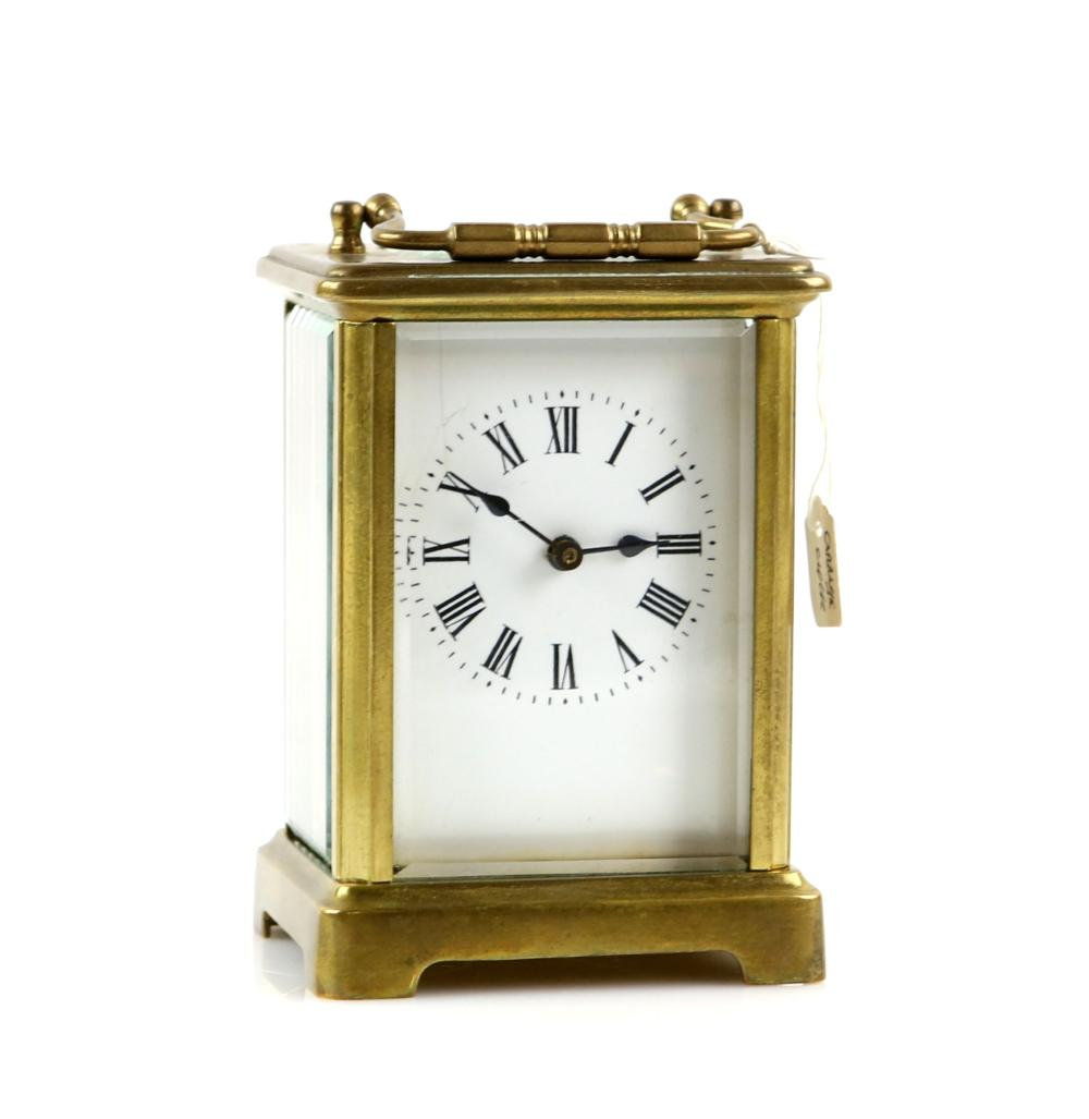 French brass and four glass carriage clock with le