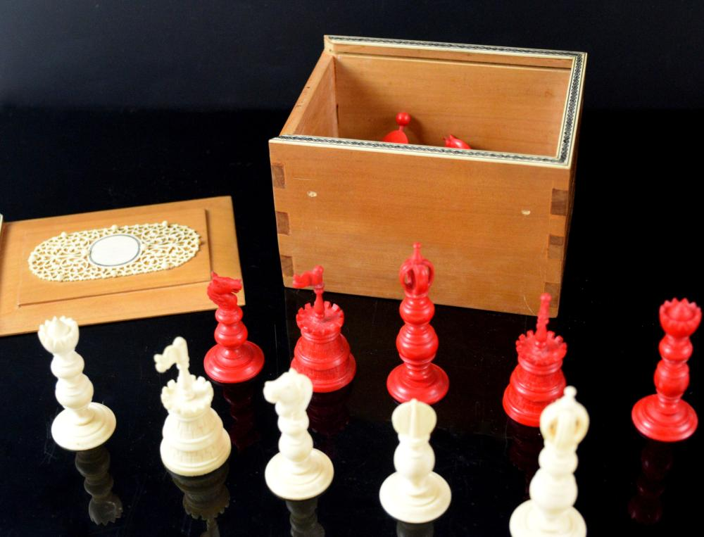 Late 19th/ early 20th century red and white ivory