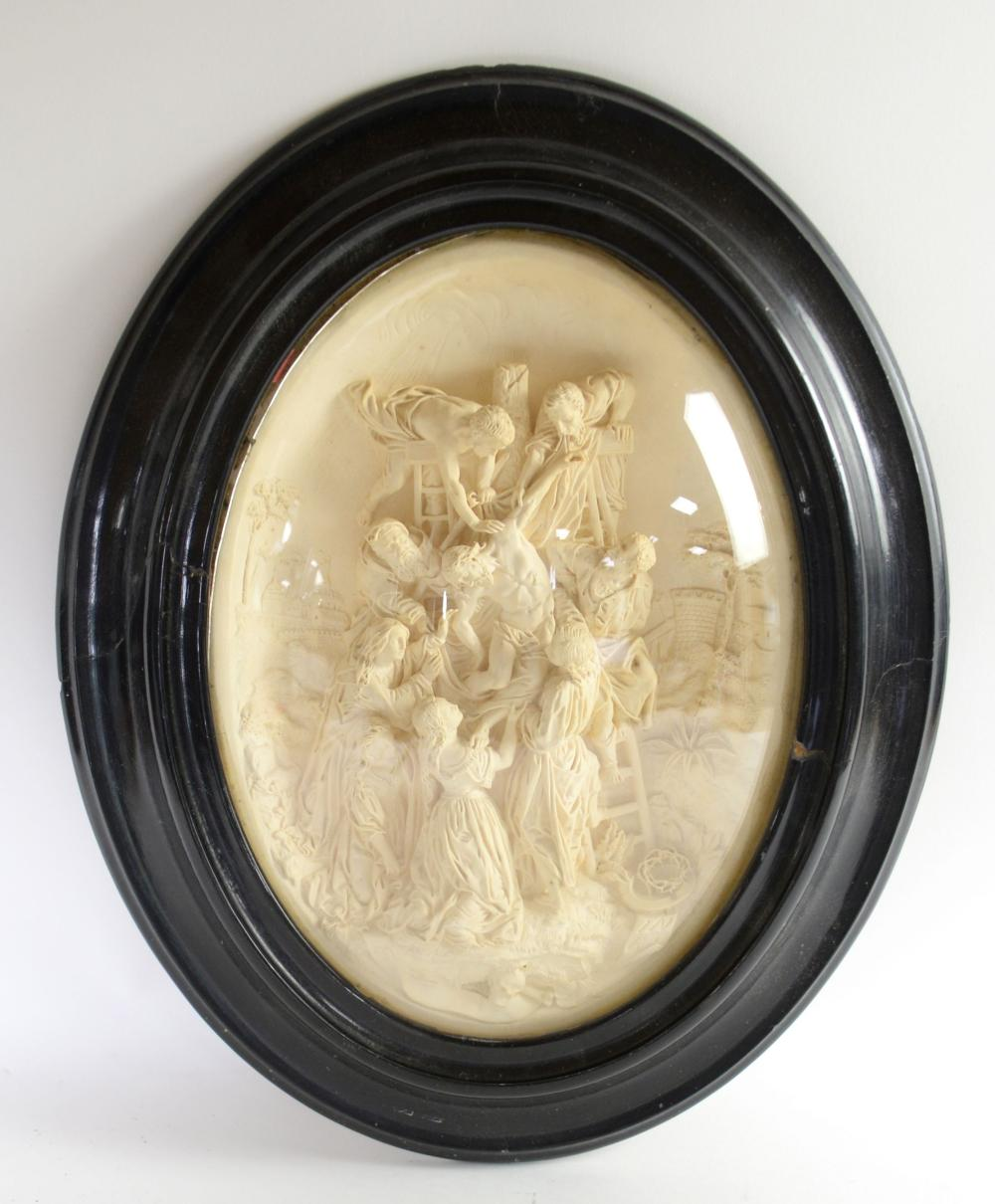 Plaster carving of Jesus being removed from the Cr
