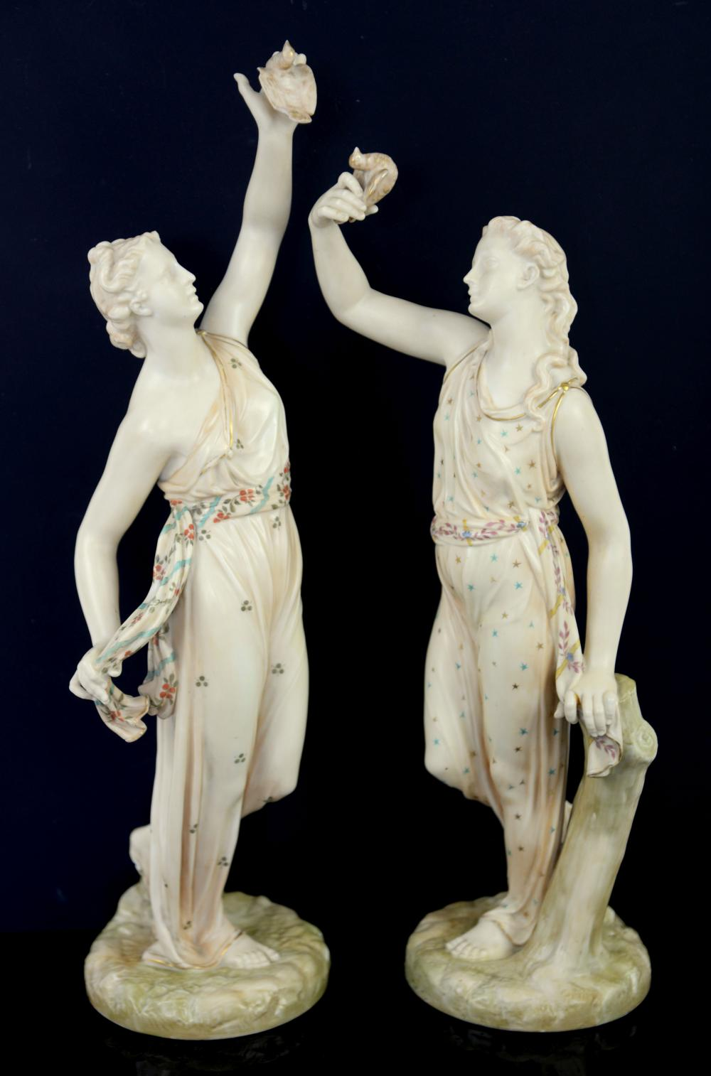 Pair of Royal Worcester blush ivory figure of  lad