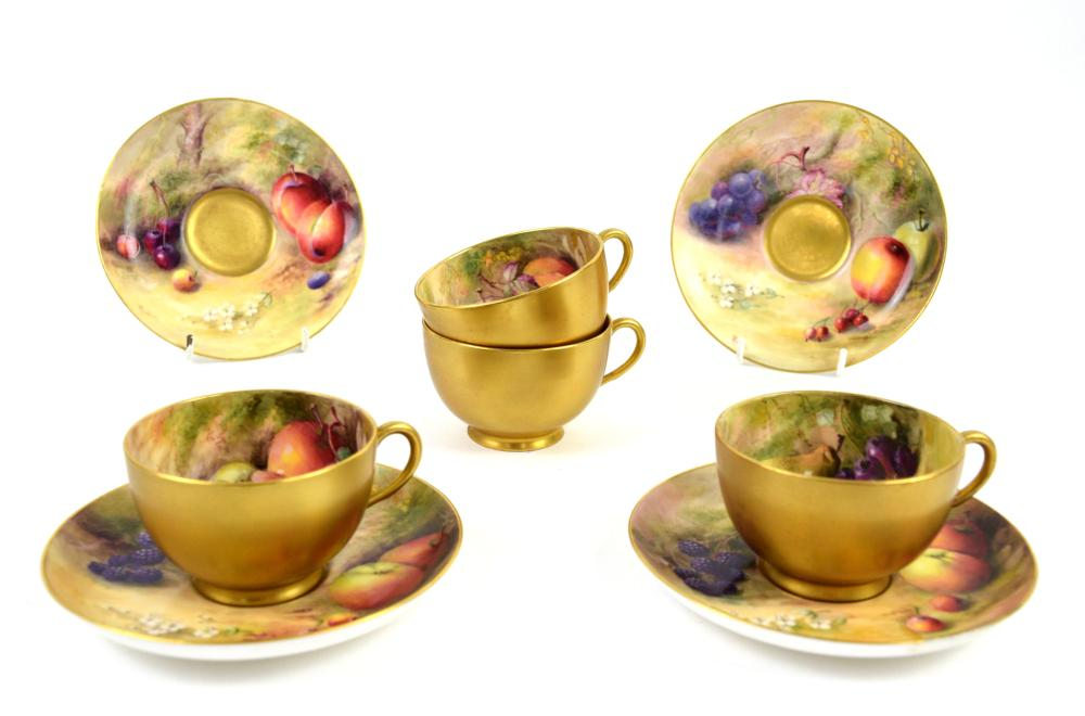 Royal Worcester set of four cabinet cups and sauce