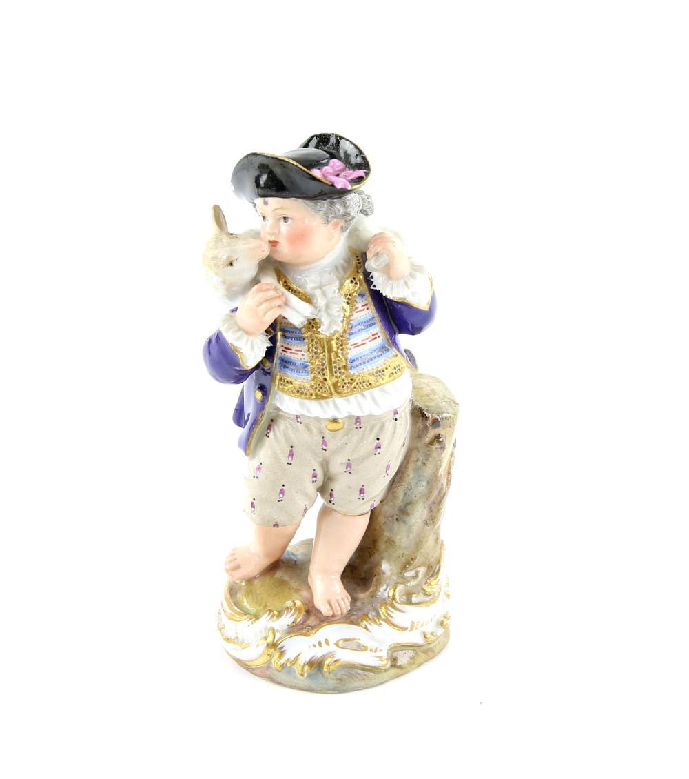 Meissen porcelain figure modelled as a a boy with