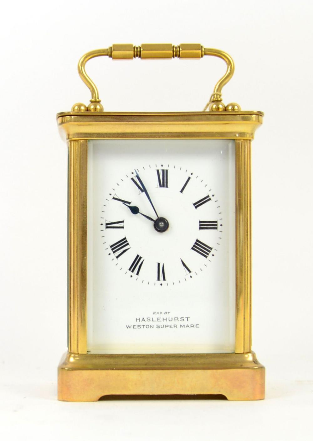 Brass and glass carriage clock with lever escapeme