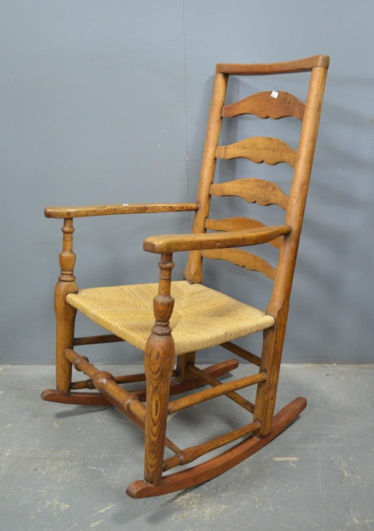 Pine ladderback rocking chair, an upholstered tub chair