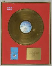 Gold Disc Presented to Gary Davies to recognise sa