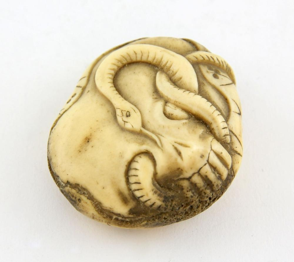 8b12ed94ebb0 Japanese ivory netsuke of a snake entwined inside