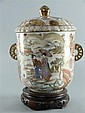 Japanese twin handled Satsuma vase and cover decorated with butterflies, flowers, and figures in exterior and interior settings,