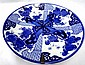 Large Japanese blue and white dish decorated with four panels of flowers and foliage,