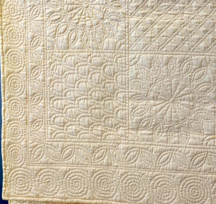 A welsh quilt of hand sewn with a series of patter