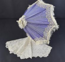 Lace parasol cover and a lilac silk and ivory carr