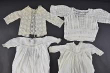 Group of lace trimmed and crocheted children's clo