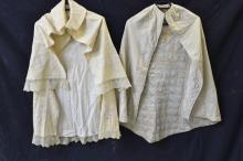 Two embroidered babies capes, cream with self colo