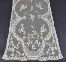 An Irish Limmerick lace stole with naturalistic de
