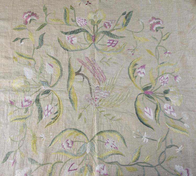 A British Colonial bed cover embroidered with diff