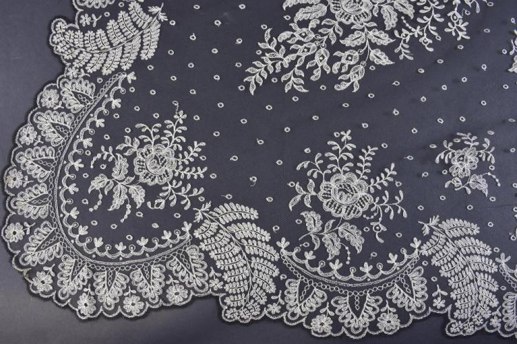 French lace, a black net shawl with cream floral d