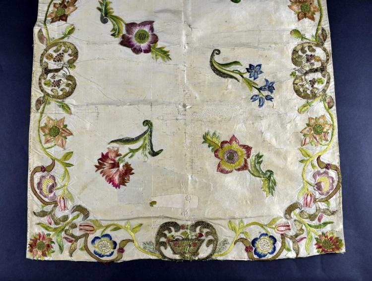 Spain 17th-18th C, a silk cover with border of scr