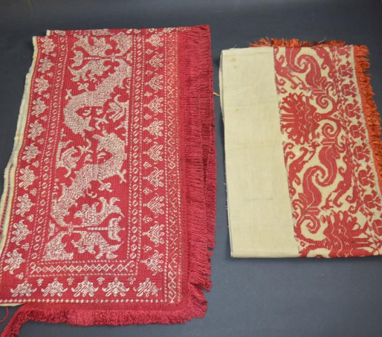 Two embroidered hangings, worked in red silk on a