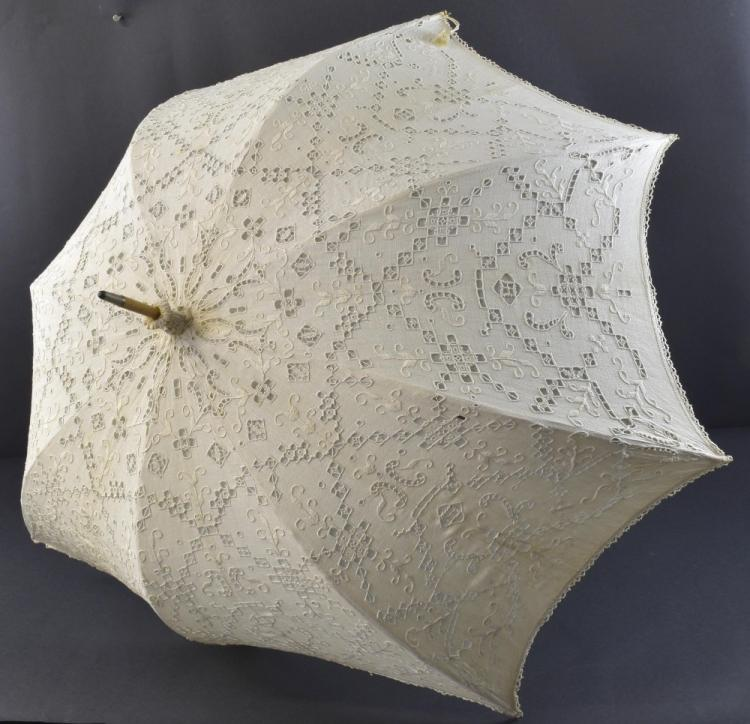Two parasols, one with black Maltese lace on grey