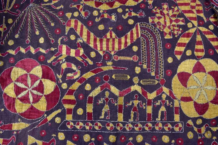 An Indian wall hanging with embroidered decoration of animals  212 x 260 cm, and a quilted cover with appliqué decoration within squares, 208 x 132 cm  and a coloured shawl  20th c. Provenance: An important collection of International Historical textiles. See lot 1000 for more details on provenance