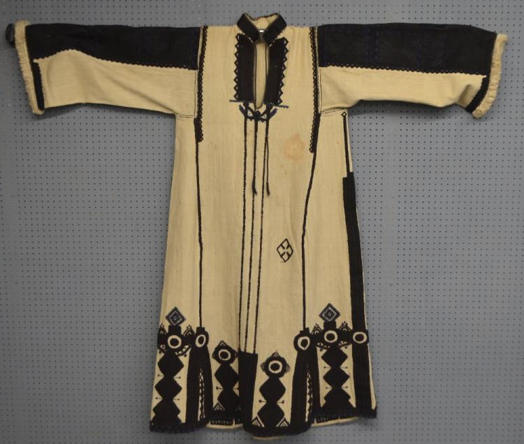 A man's robe of course linen with panels of count