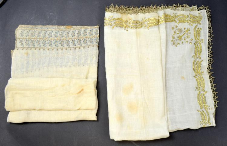 Ottoman head scarf, cream muslin, with embroidery of two widths of gold thread, each corner with a floral spray, decorated border and metal lace edging, 90 x 82 cm.and an embroidered muslin scarf with silver embroidery of blossoming branches Provena