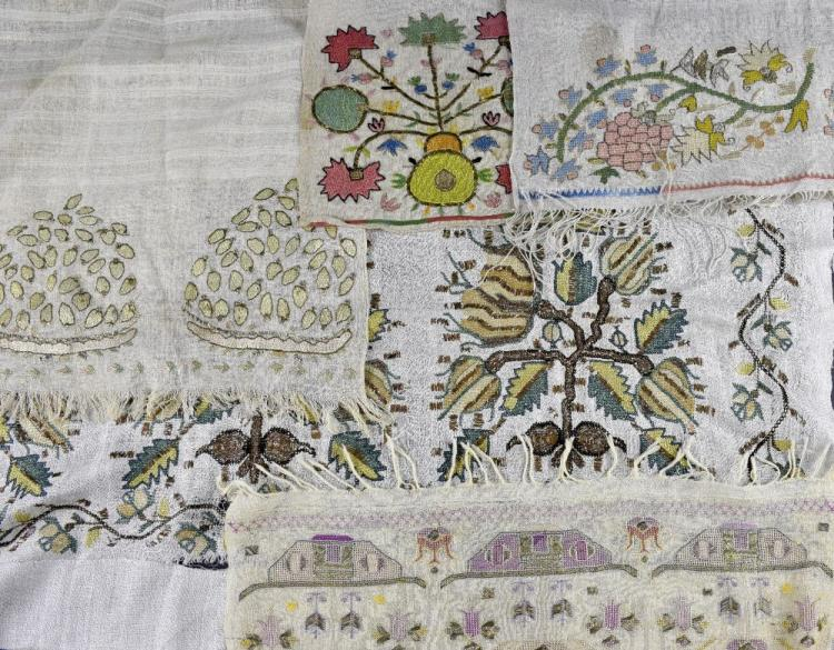 Four Turkish towels, all  with embroidered decorat