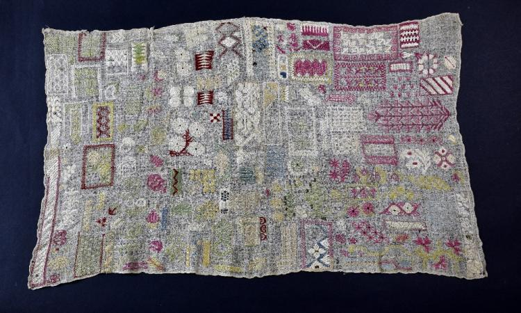 An Unusual  19th C Persian sampler, embroidered m