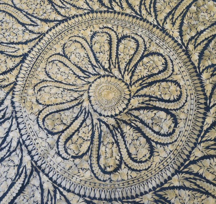 A fine Indian Delhi work shawl worked in silk on f