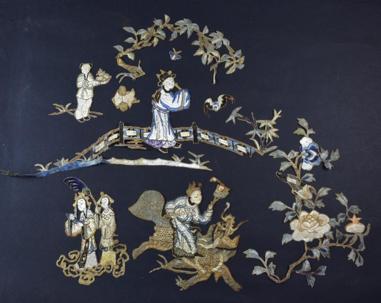 A number of motifs cut from a panel, an embroidere