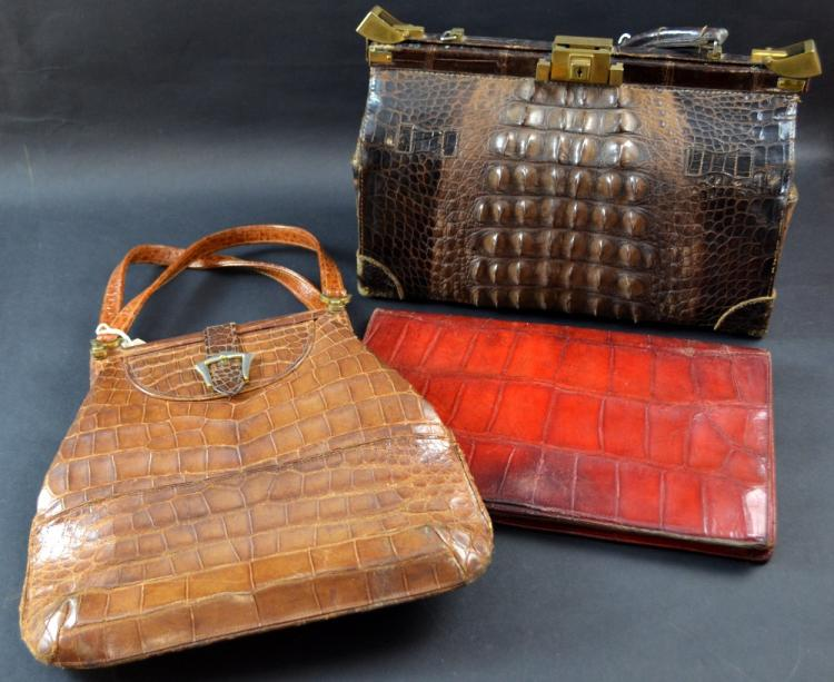 Three crocodile bags, a 'doctor' bag in brown, tan