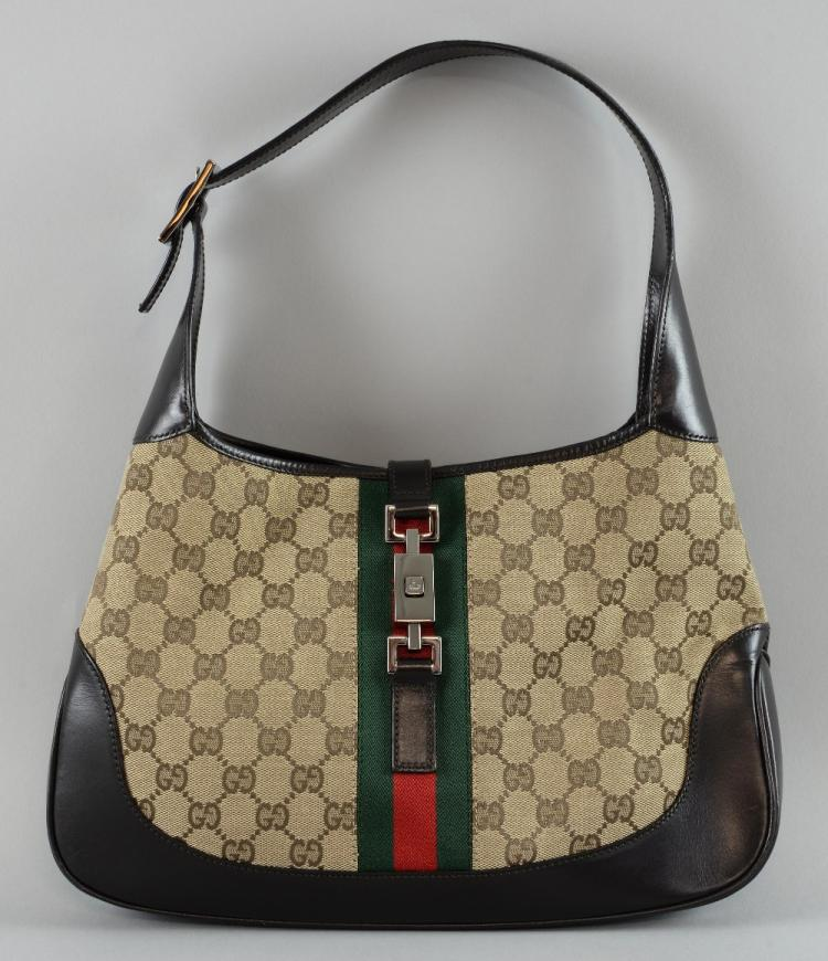 Gucci Jackie Monogram canvas bag, the body 23 x 31