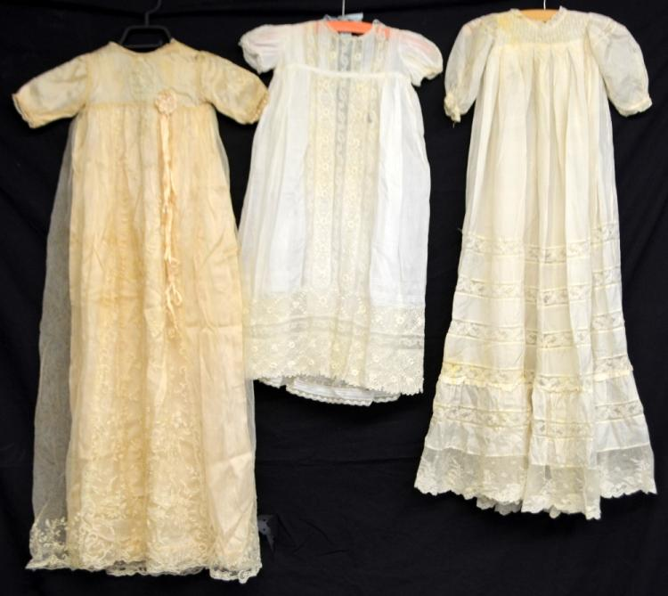 Three christening robes, one with panels of lace,