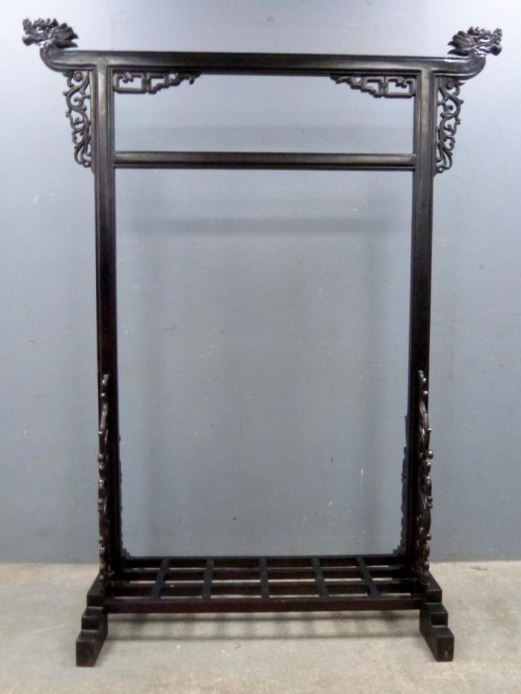 Chinese black lacquer robe stand carved with drago
