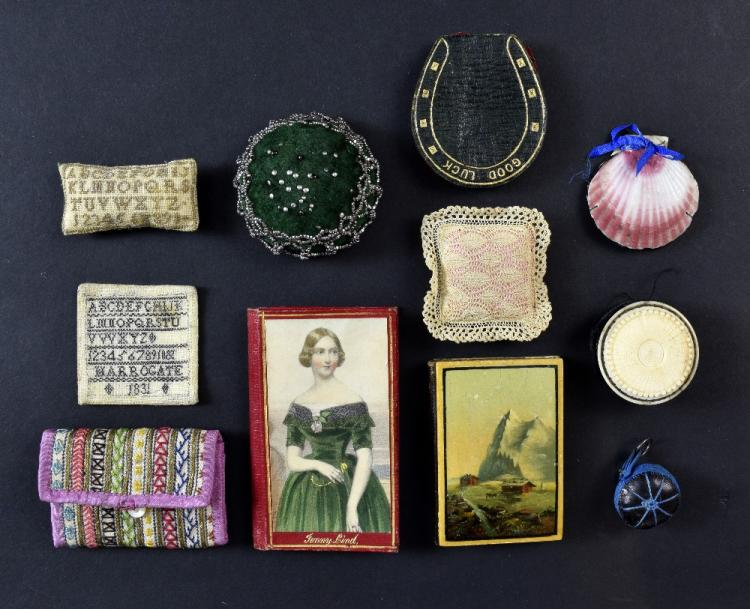 A Collection of needle cases and pin cushions, one