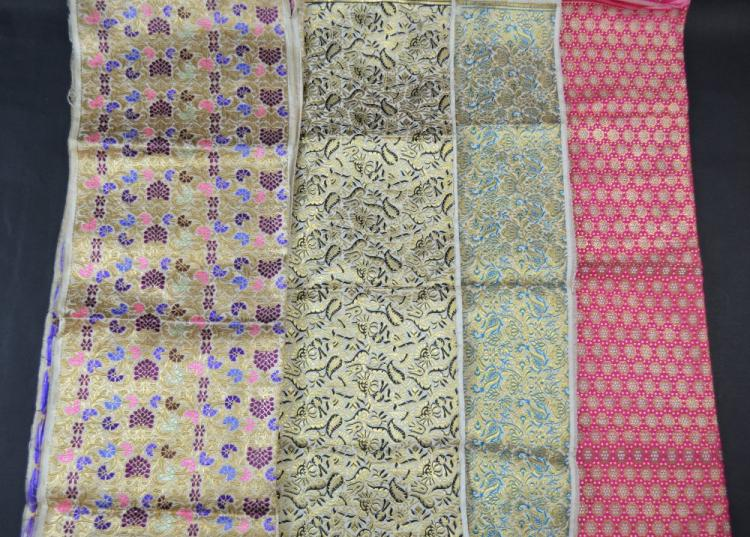 Four Chinese brocaded silk panels all with stylise