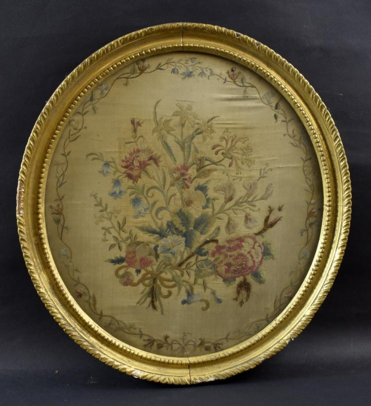 Oval floral silk work panel, 39cm x 35.5cm, in gil