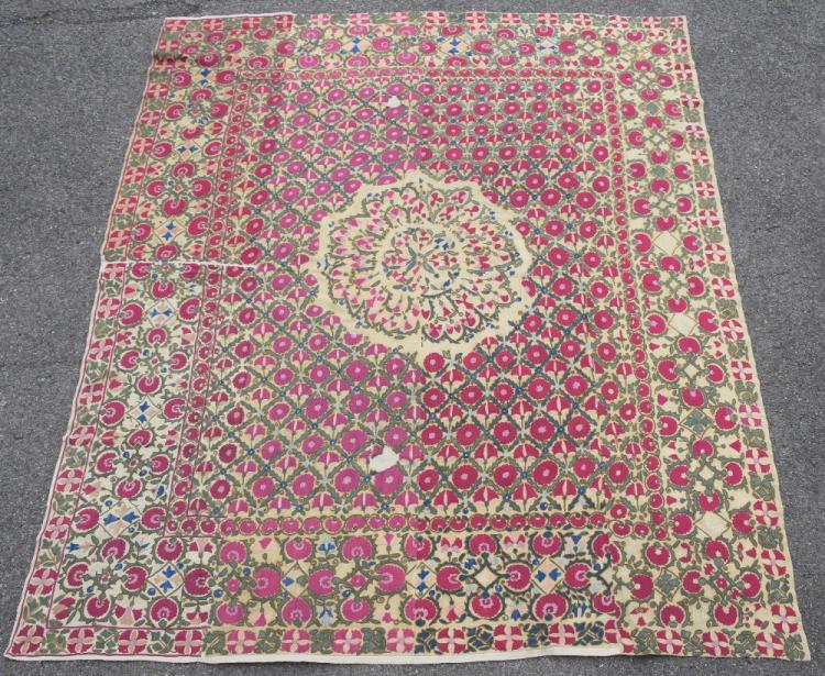 Suzani, west Turkistan, early 19th C, finely stitched floral design radiating from the centre, on diamond grid pattern with carnation flower heads, border with quatrefoil floral motifs, constructed of four longitudinal panels, 188 x 220 cm  See lot 1000 for more details on provenance