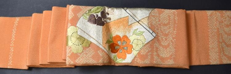 Two Japanese silk obi, one orange silk crepe with